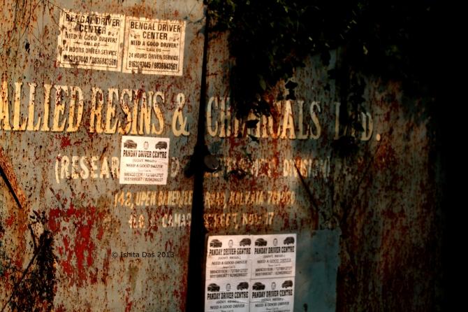 A chemical factory gate, Kolkata, near a small airport