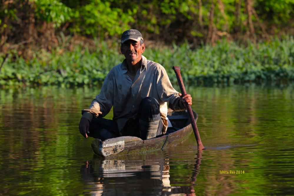 man and canoe