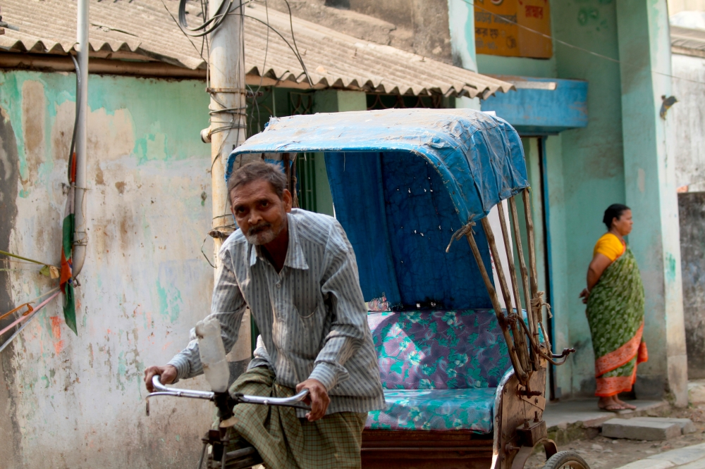 man and his rickshaw