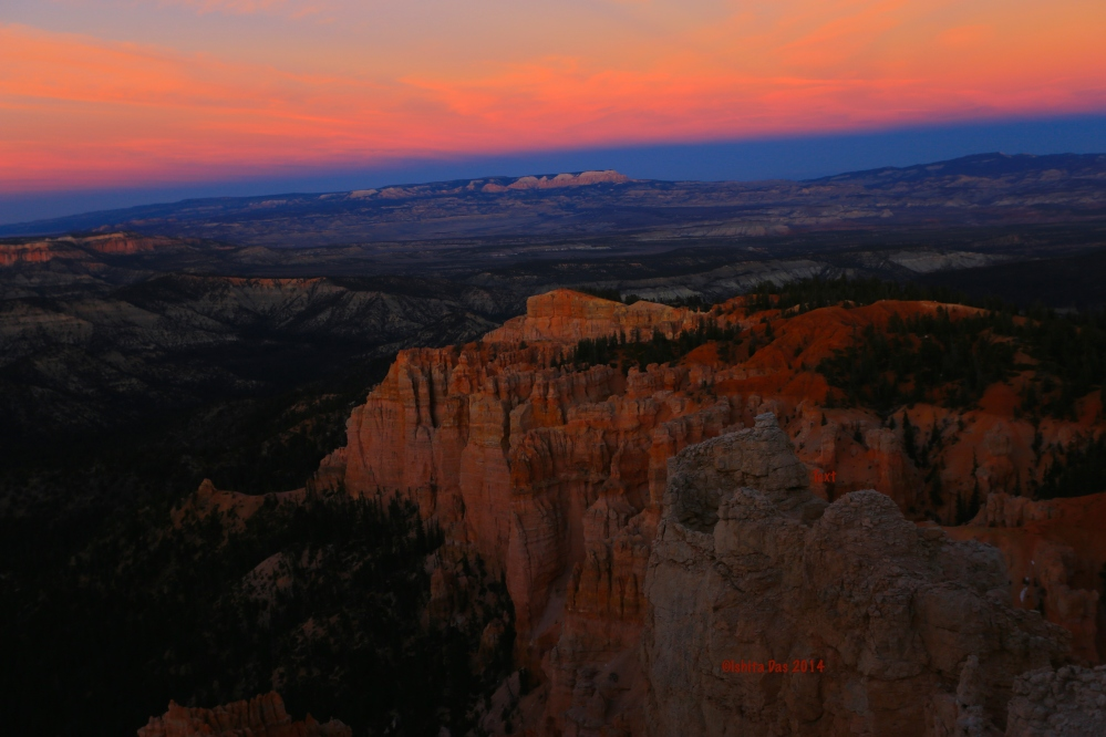 Sunset's reflection at Rainbow point
